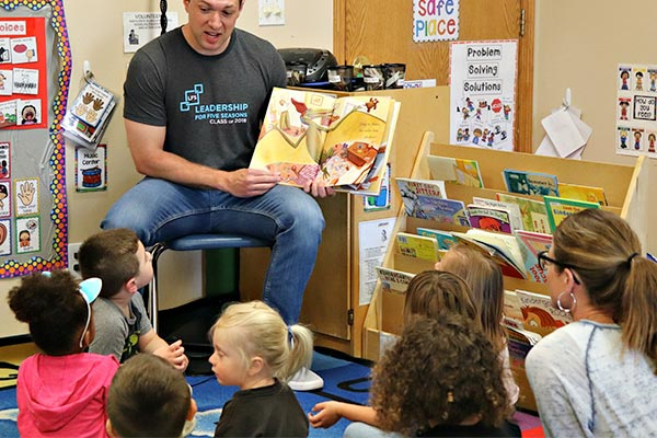 Volunteer reading to head start kids