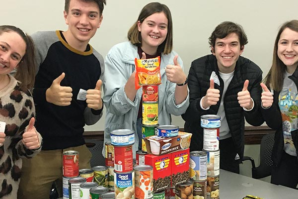 Volunteers hosting a food drive
