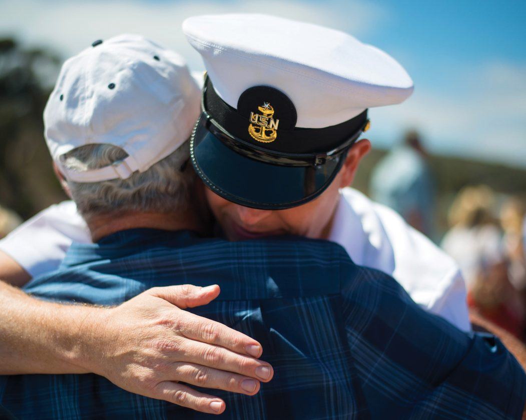 Veteran Hugging Family